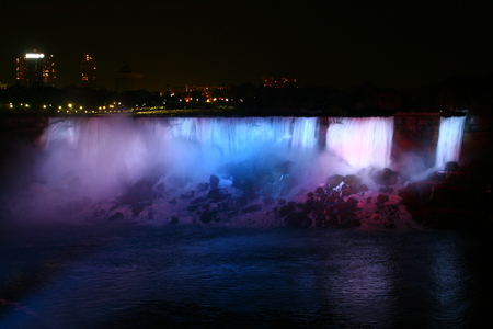 Niagra falls flood lighting at night with different colors Фото со стока