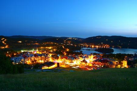 Tremblant village and lake at night Фото со стока
