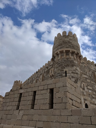 Qaetbay citadel with  skies and clouds Редакционное