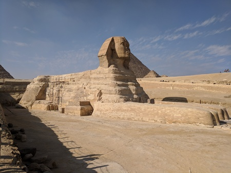 The sphinx with a background having the pyramids
