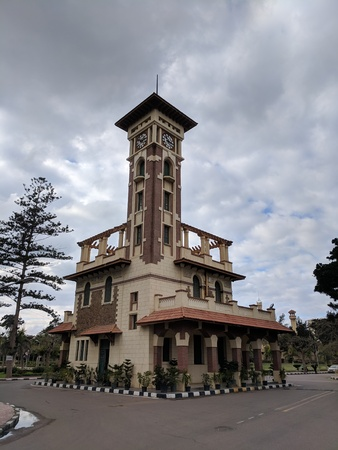 Montazah palace clock tower in the middle of the gardens Фото со стока