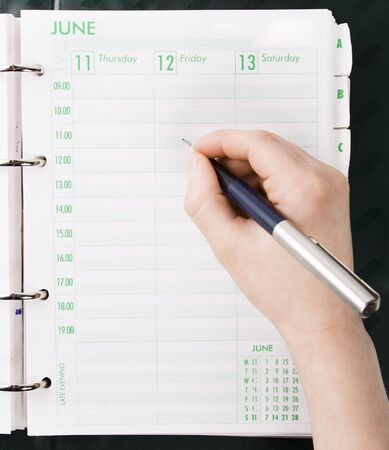 working week: Hand Writing in to Personal Organizer
