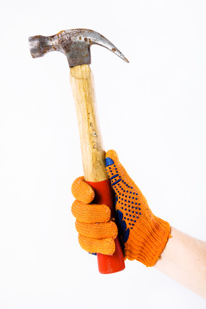 Hammer in hand on white photo