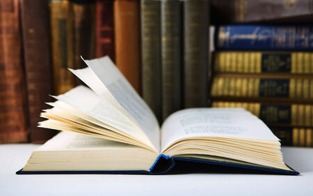 bibliomania: Old Open book in  Library Stock Photo