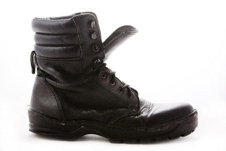 steel toe boots: Black military boot on white background