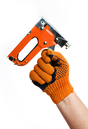Staple Gun in hand on white photo