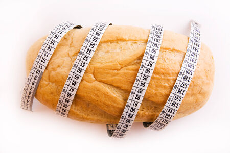 mesure: diet concept - bread and tape measure