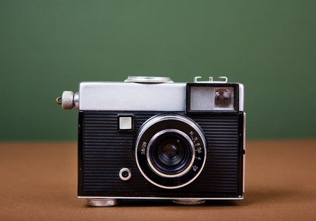 Vintage camera on green background photo