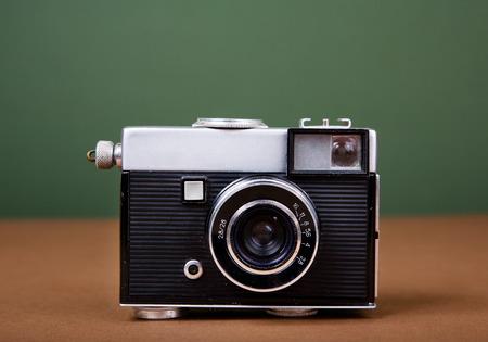 Vintage camera on green background