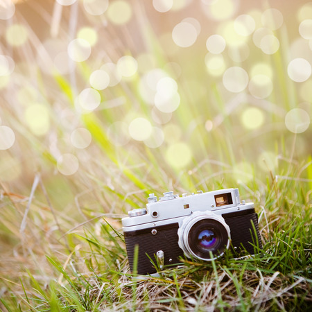 Summer backgound with retro camera and bokeh