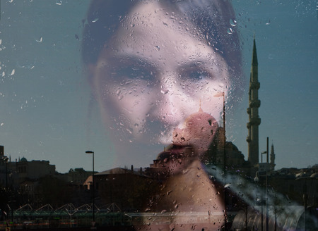 woman in depression, mosque reflection photo
