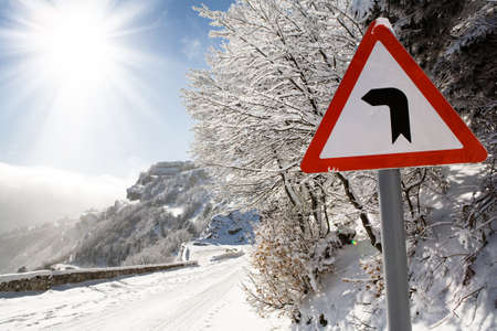 road sign on a mountain road photo