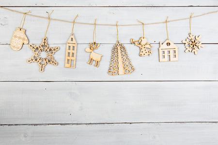 angel tree: christmas decoration on wooden table -  snowflakes, angel, tree etc