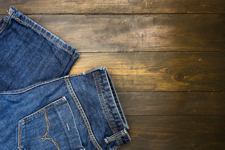 cotton  jeans: Blue jeans  on wooden board