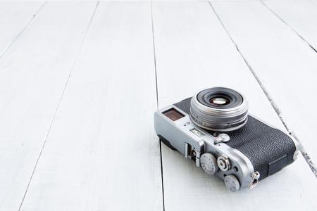 Retro style digital camera on wood
