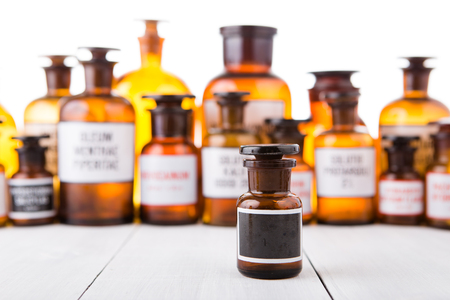brown bottles: medicine bottle with blank label on wooden table Stock Photo
