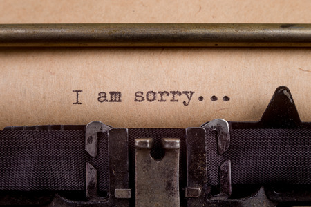 i am sorry: I am sorry - typed words on a Vintage Typewriter Stock Photo