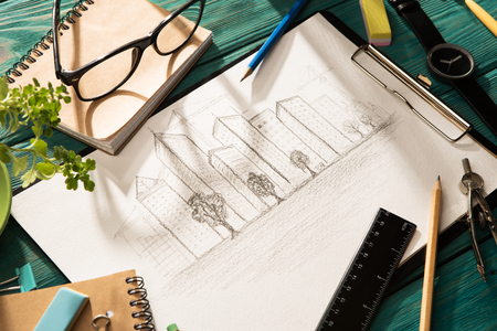 Real estate concept - sketch of architecture on the desk
