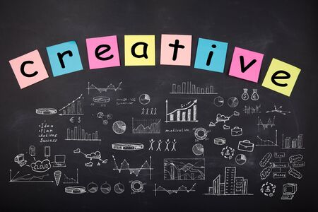 Business concept - word ' Creative', sketch with schemes and graphs on chalkboard Banque d'images