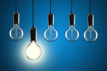 Idea and leadership concept Vintage incandescent Edison type bulb on color wall