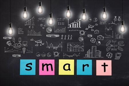 Business concept - word ' Smart ', sketch with schemes and graphs on chalkboard Banque d'images