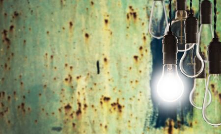 Teamwork and innovation concept - vintage bulbs on the wall background