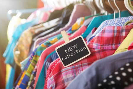 New collection clothes hanging on the rack in the fashion store Banque d'images