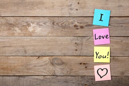 I love you inscription on colorful stickers on blackboard Banque d'images