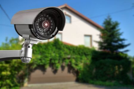 Security camera and private house on the background Banque d'images