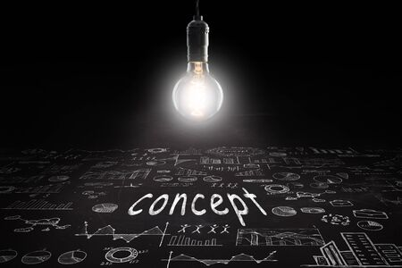 Business concept - word 'Concept ', sketch with schemes and graphs on chalkboard Banque d'images