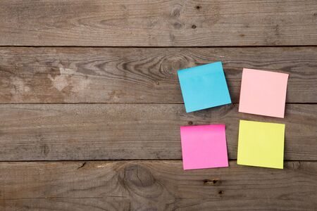 Colorful sticky notes on the blank blackboard