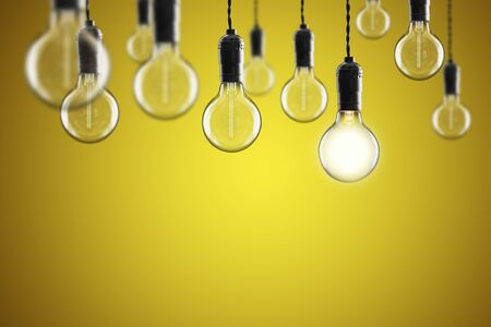 Idea and leadership concept Vintage incandescent Edison type bulbs on color wall