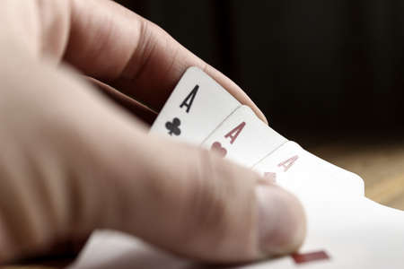 Playing cards in hand close-up. Poker.