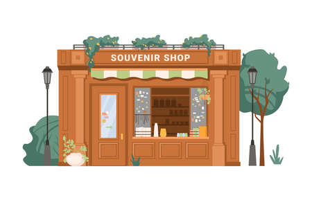 Souvenir shop facade exterior isolated small retail business building flat cartoon. Vector antique store, collectables in shop window, presents, gifts, decorative vases. Green trees, street lamps