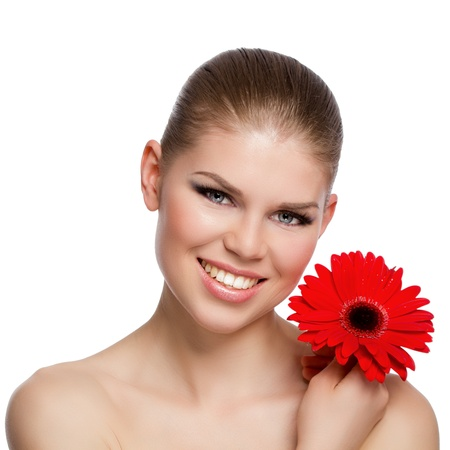 Portrait of happy smiling young Caucasian woman holding a red flower  Facial treatment, body, skincare concept  Isolated on white background  photo