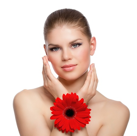 Facial skin moisturizing  Pretty woman with red flower, isolated photo