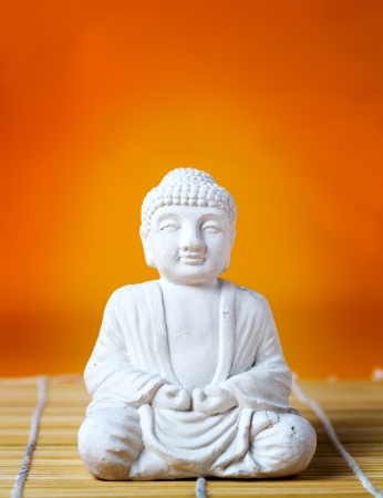 Buddha statue on bamboo mat  photo