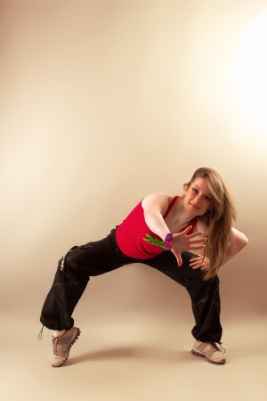 Attractive young woman doing aerobics zumba fitness in studio photo
