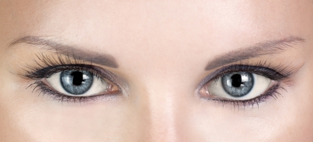 false eyelash: Woman blue eyes with beautiful long eyelashes