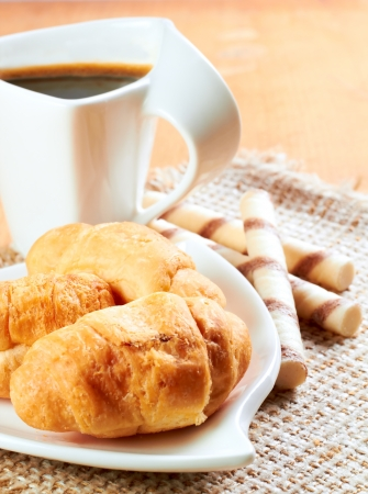 Breakfast with coffee and fresh croissants photo