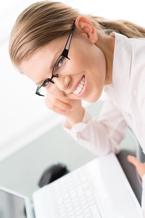 Smiling woman economist accountant photo
