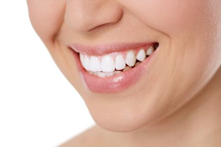 smile close up: Perfect smile of young woman after teeth whitening  Dental care concept  Isolated over white background  Stock Photo