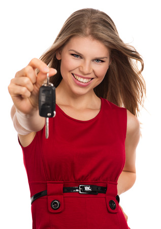 automobile dealers: Happy blonde holding car key, isolated on white background  Beautiful young joyful female new car owner
