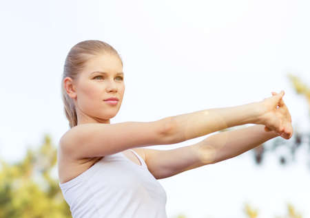 start to cross: Concentrated woman athlete exercising, stretching hands