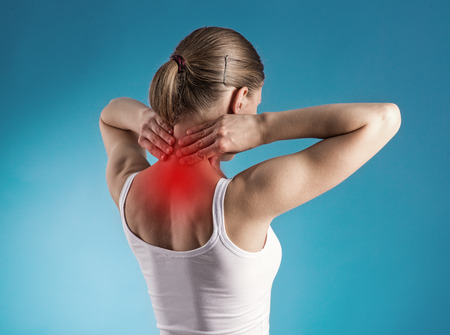 Healthy lifestyle  Back and spine disease  Close-up portrait of tired female massaging her neck