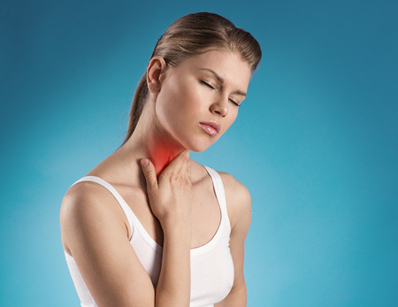 headache pain: Angina virus  Young woman having throat pain