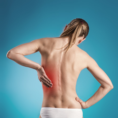 arthritis back: Acute kidneys pain shown with red on woman s body over blue background