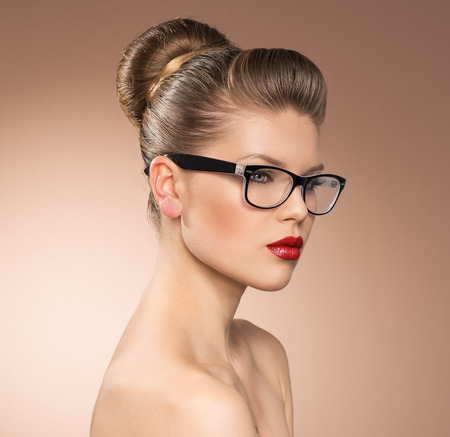 Strict vintage style lady with red lipstick wearing spectacles  Eyewear glasses woman closeup portrait  photo