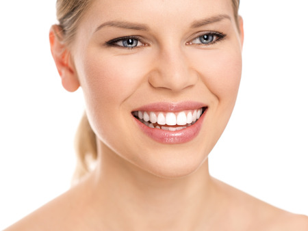 Portrait of young beautiful smiling woman on white background  Teeth whitening  Dental care