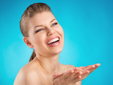 Happy smiling female dentist with wide healthy smile  Dental care, protection and treatment concept  photo
